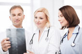 Doctors looking at x-ray — Stock Photo