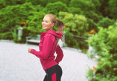 Sporty woman running or jumping — Stock Photo