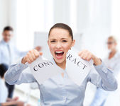 Serious businesswoman tearing contract — Foto Stock