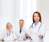 Calm female doctor with clipboard — Foto Stock