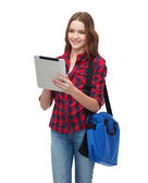 Smiling student with tablet pc and bag — Stock Photo