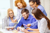 Smiling team with color samples at office — Stock Photo