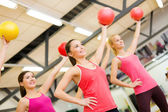 Group of people working out with stability balls — 图库照片