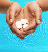Womans cupped hands showing euro coins — Foto Stock