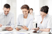Business team working with tablet pcs in office — Stock fotografie