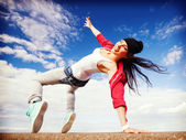 Beautiful dancing girl in movement — Stock Photo