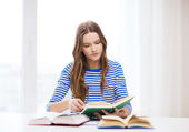 Concentrated student girl with books — Stock Photo