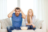 Upset couple after sports team loss — Foto Stock