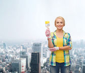 Smiling woman with paintbrush — Stock Photo