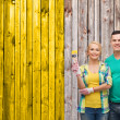 Smiling couple with paintbrush — Stock Photo #43019963