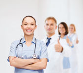 Smiling female doctor or nurse with stethoscope — Stock Photo