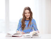 Happy smiling student girl with books — Stok fotoğraf