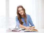 Happy smiling student girl with books — Stock fotografie