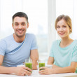 Smiling couple having breakfast at home — Stock Photo #43058113