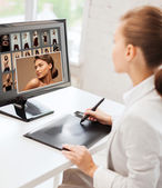 Female retoucher working at home or office — Stock Photo