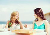Girls in cafe on the beach — Photo