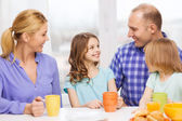 Happy family with two kids with having breakfast — Foto de Stock