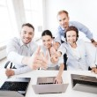 Group of office workers showing thumbs up — Stock Photo #43263933