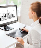 Architect with drawing tablet in office — Stock Photo
