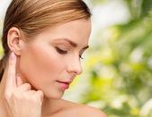Calm woman touching her ear — Stok fotoğraf