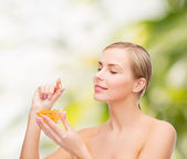 Lovely woman with omega 3 vitamins — Stockfoto