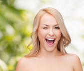 Beautiful woman with long wavy hair — Stock Photo