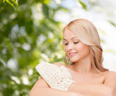 Smiling woman with exfoliation glove — Foto Stock