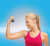 Young sporty woman with light dumbbell — Photo