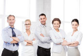 Happy business team in office — Stock Photo