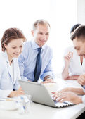 Businessman with team on meeting in office — ストック写真