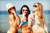 Girls in bikini with ice cream on the beach — Photo