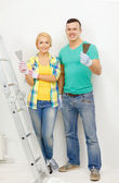 Smiling couple doing renovations at home — Stock Photo