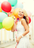 Woman with colorful balloons — 图库照片