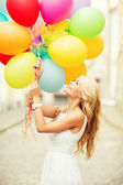 Woman with colorful balloons — Stock Photo