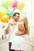 Couple with colorful balloons — Foto de Stock