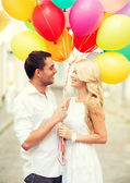 Couple with colorful balloons — Stockfoto