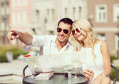 Couple with map in cafe — Stockfoto