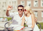 Couple taking photo in cafe — Photo