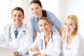 Group of doctors with laptop computer — Stock Photo