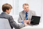 Older man and young man with laptop computer — Stock Photo