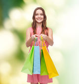 Smiling woman in dress with many shopping bags — Stok fotoğraf