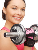 Asian sporty woman with heavy dumbbell — Stock Photo