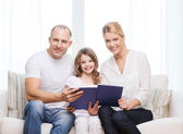 Smiling parents and little girl with at home — Stock Photo