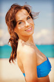Beautiful woman on a beach — Stock Photo