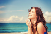 Laughing woman on the beach — Foto Stock