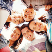 Group of teenagers looking down — Foto Stock