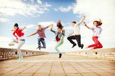 Group of teenagers jumping — Photo
