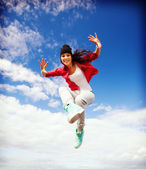 Beautiful dancing girl jumping — Stock fotografie