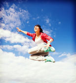 Beautiful dancing girl jumping — Photo