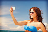 Happy woman with phone on the beach — Stock Photo